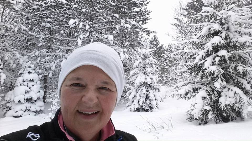 Tina Coughley enjoying our new Pines Loop inside of Hartwick pines State Park for Forbush corner's winter trails day